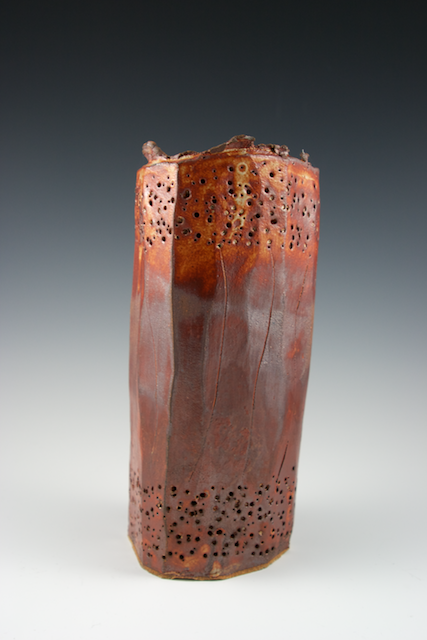 Tall, perforated vessel
